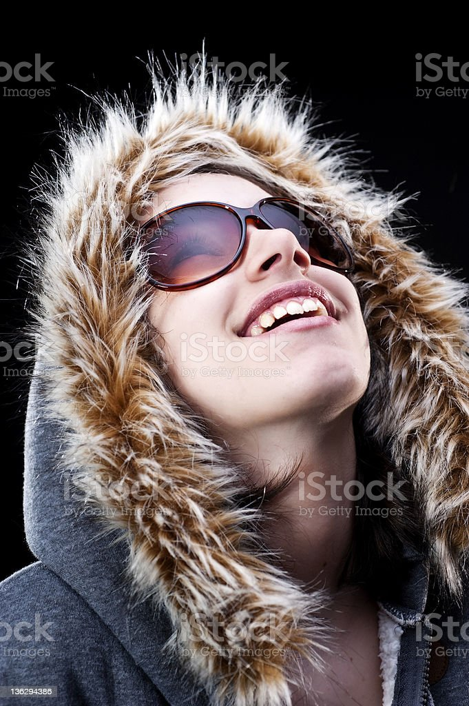 Girl with parka looking up stock photo