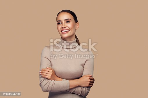 Girl with perfect smile is posing at the studio