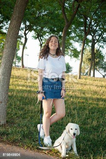 istock Girl with pet labrador retriever 819849904