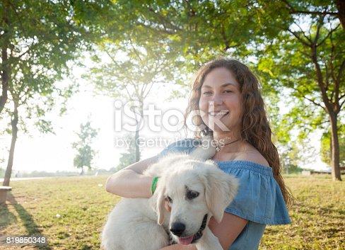 istock Girl with pet labrador retriever 819850348