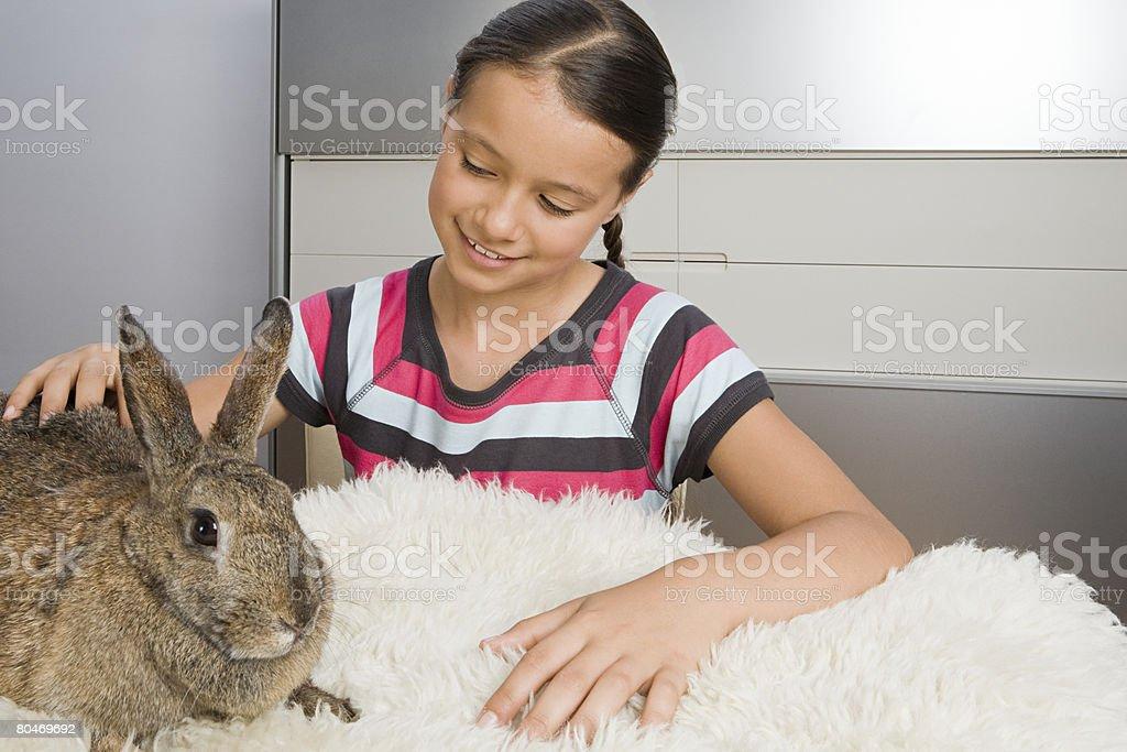 Girl with pet rabbit 免版稅 stock photo