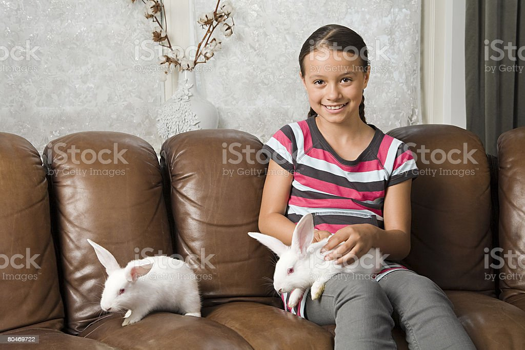Girl with pet rabbits 免版稅 stock photo