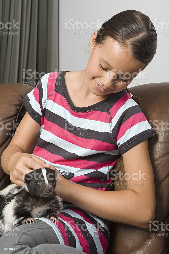 Girl with pet skunk 免版稅 stock photo