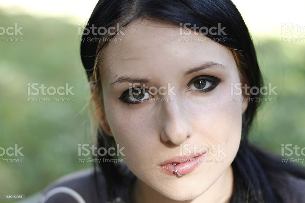 Girl with pierced lip stock photo