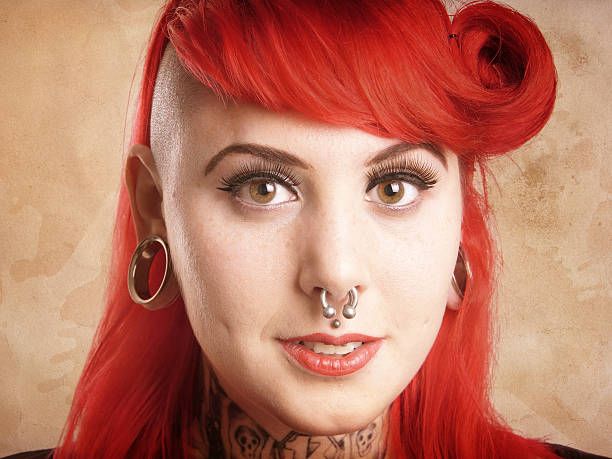 girl with piercings and tattoos - nose ring stock pictures, royalty-free photos & images
