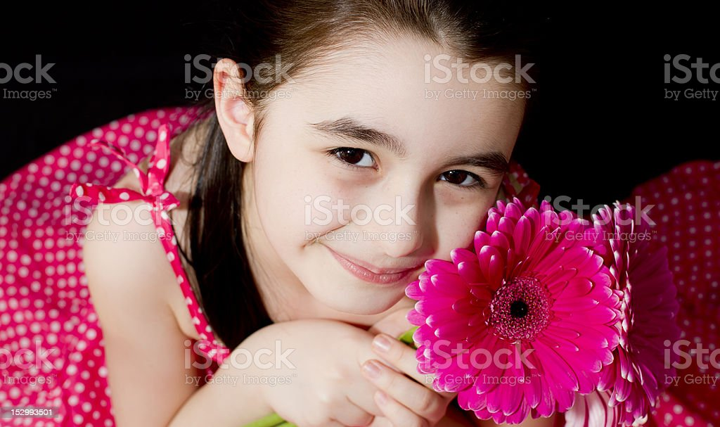 Girl with pink flower royalty-free stock photo