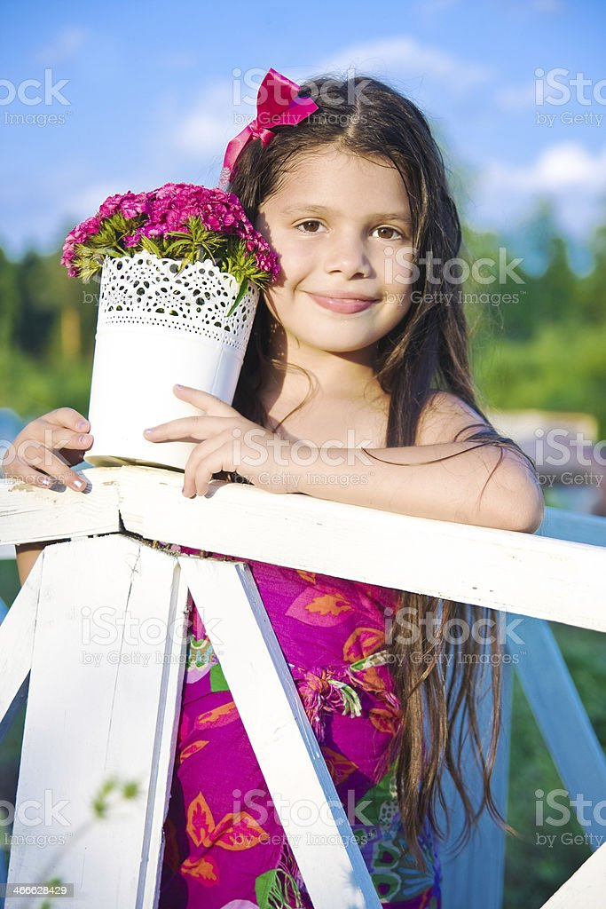 Girl with pink flowers royalty-free stock photo