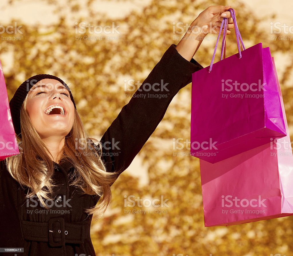 Girl with pink shopping bags royalty-free stock photo