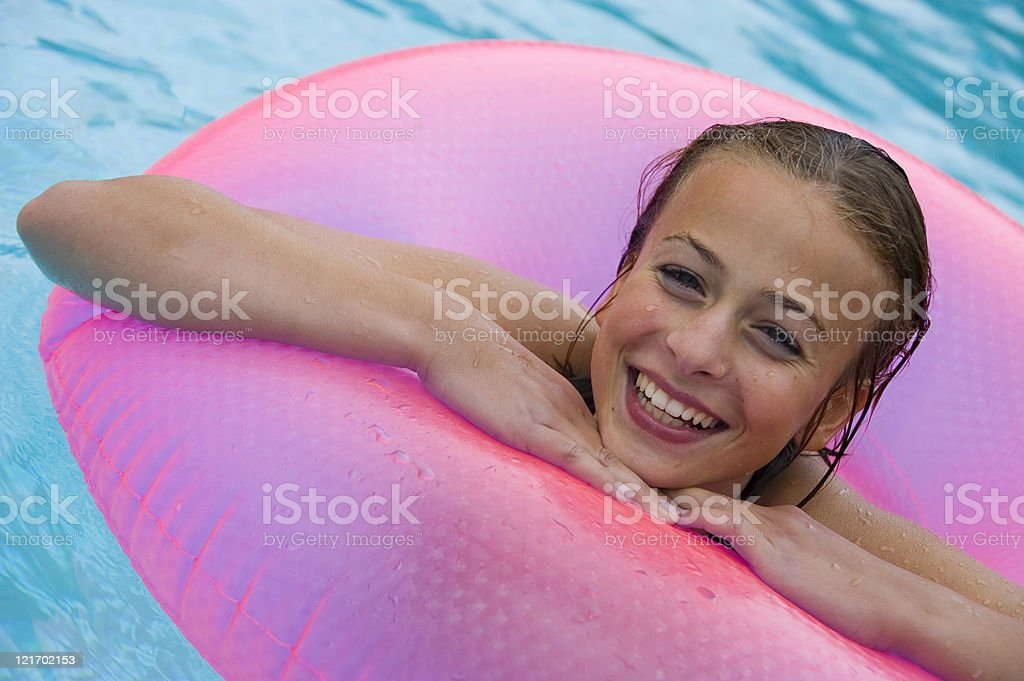 Girl with pink swimming tube royalty-free stock photo