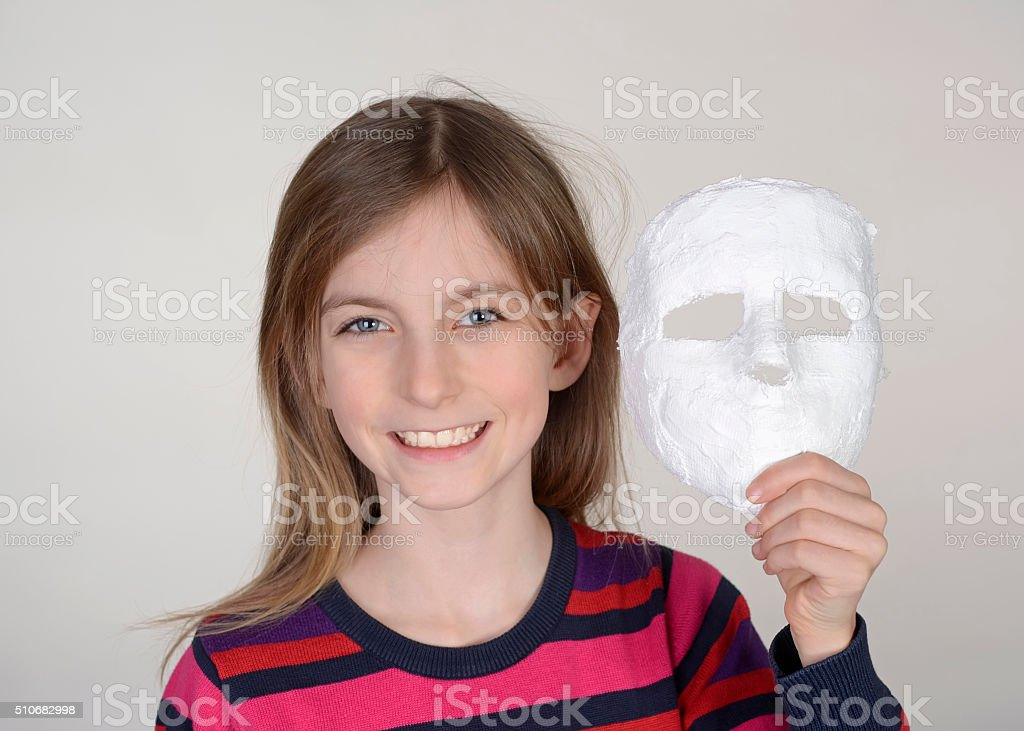 girl with plaster mask stock photo