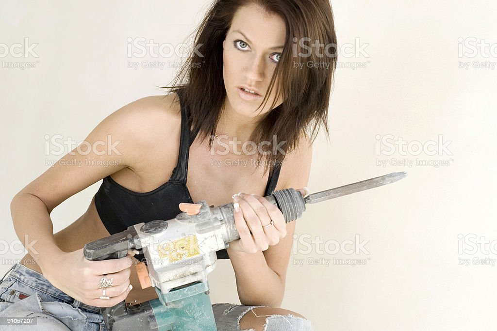 Girl with pneumatic drill [2] stock photo