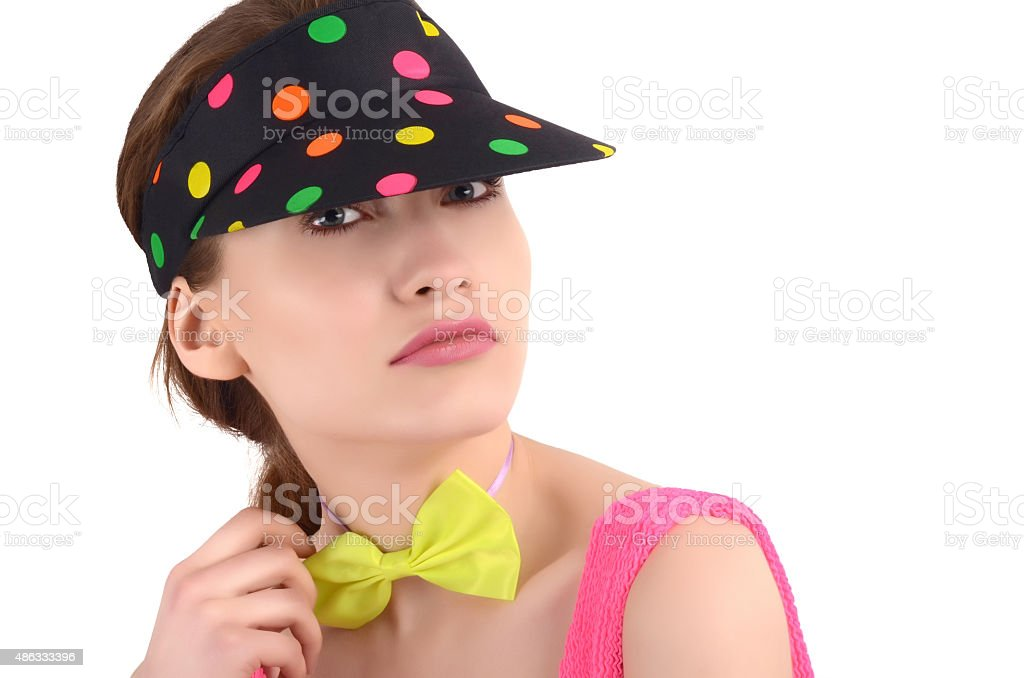 Girl with polka dots visor and bowtie. stock photo