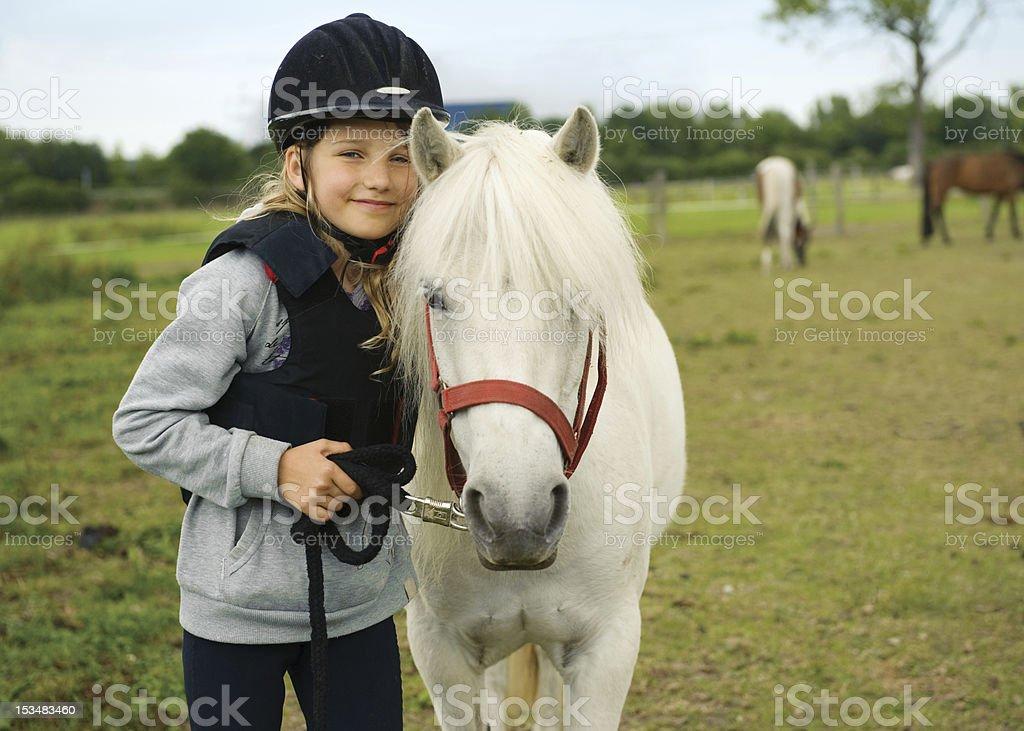 Girl with pony stock photo