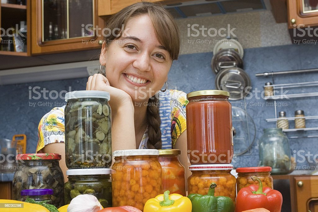 Girl with preserves royalty-free stock photo