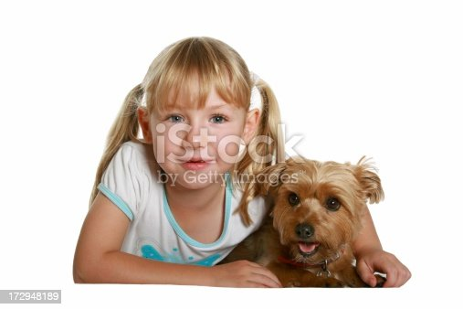 Happy little girl with her cute puppy dog. Click to see more...