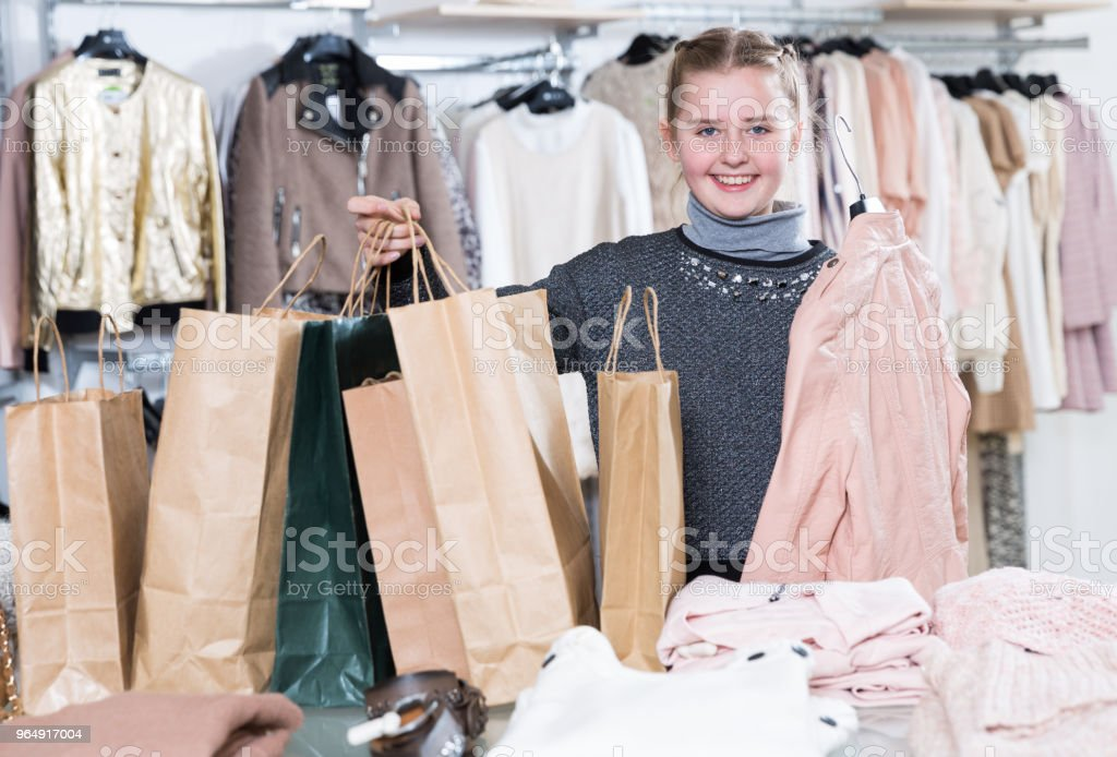 Girl with purchases in clothes store royalty-free stock photo