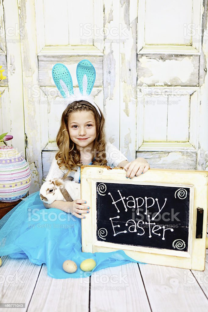 Girl with Rabbit and 'Happy Easter' Sign royalty-free stock photo