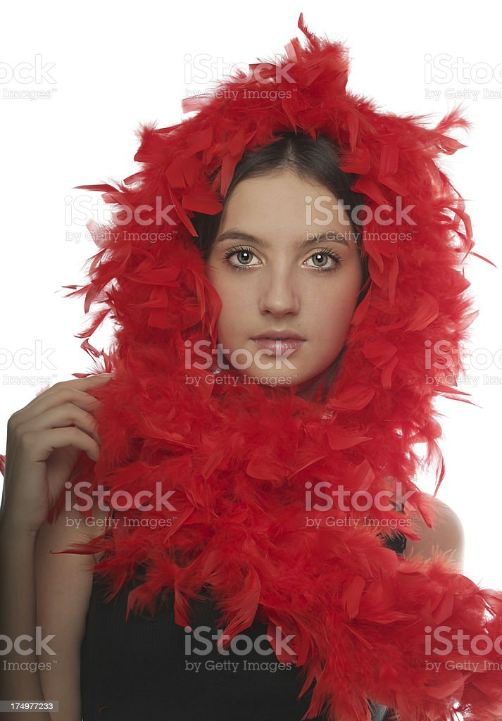 Girl with red boa feathers on white royalty-free stock photo