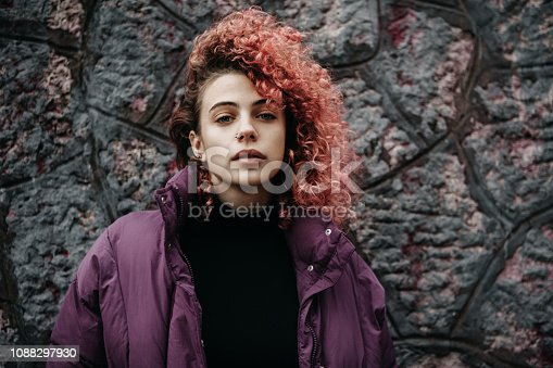 Girl with red hair on the city streets.
