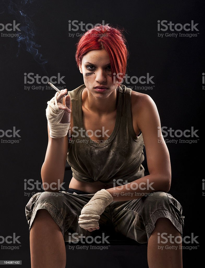 Girl with red hair, smoking royalty-free stock photo