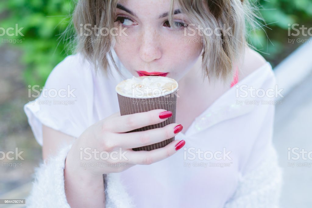 Girl with red lips drinks cappuccino - Royalty-free Adult Stock Photo