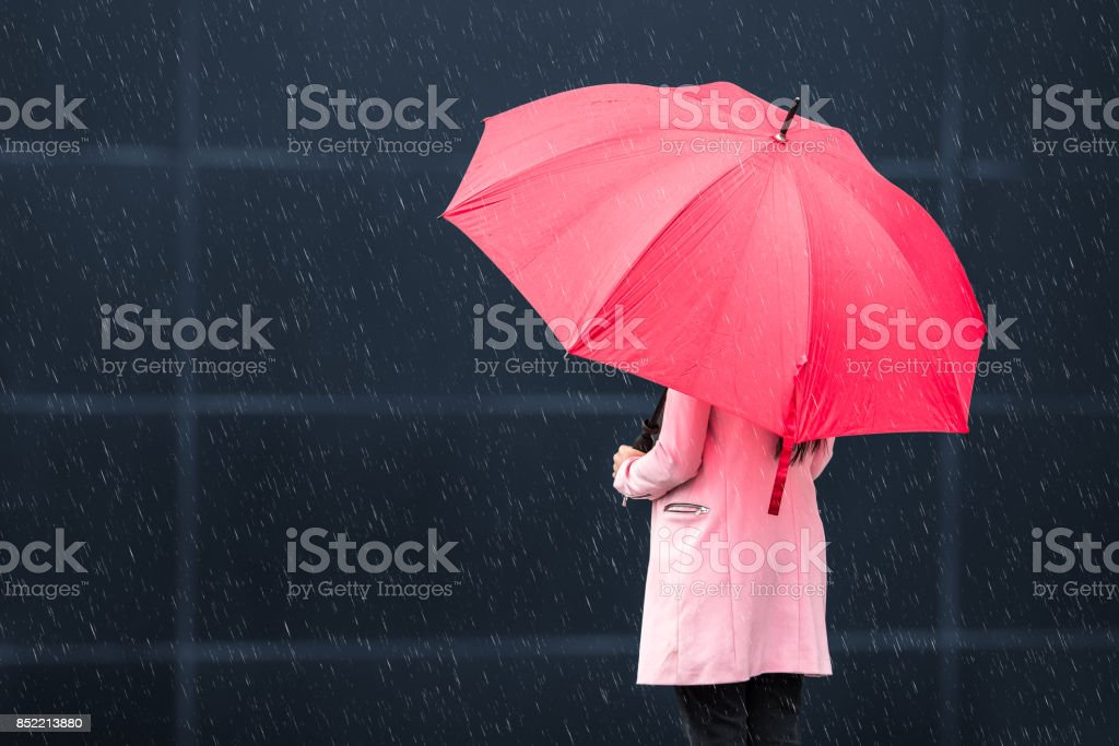 Girl with red umbrella on rainy day Girl with red umbrella on rainy day Adult Stock Photo