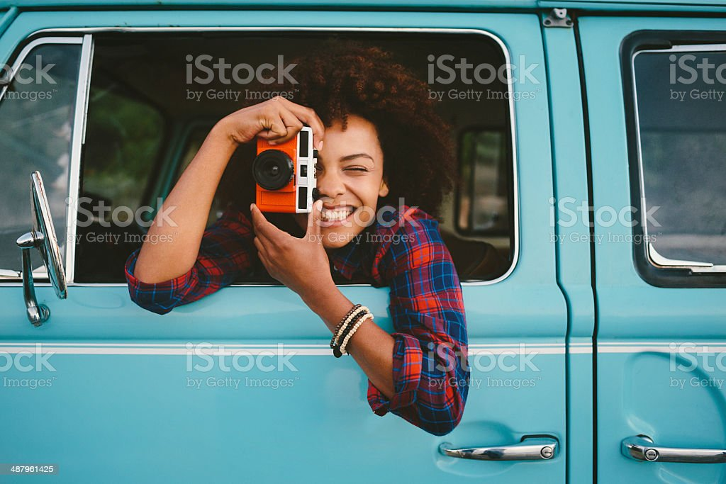 Girl with retro camera stock photo