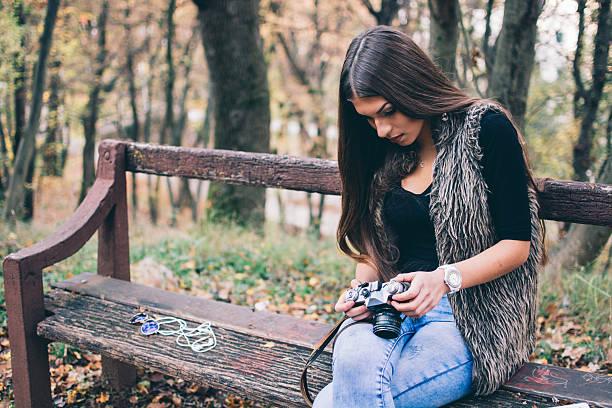 Girl with retro film camera and smartphone stock photo