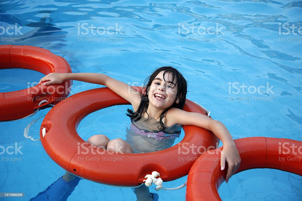 Girl with ring buoys royalty-free stock photo