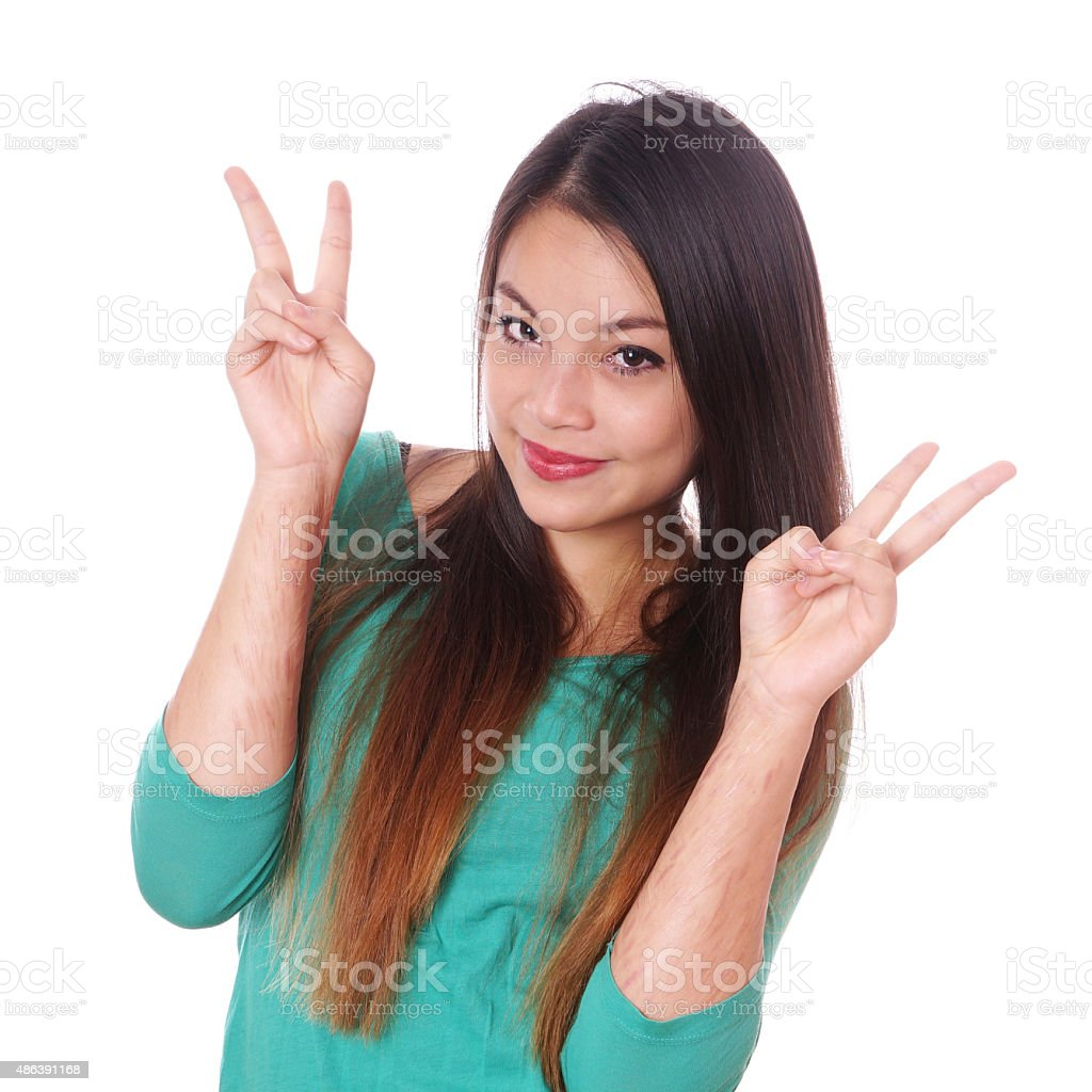 girl with scars from self-harm making victory sign stock photo