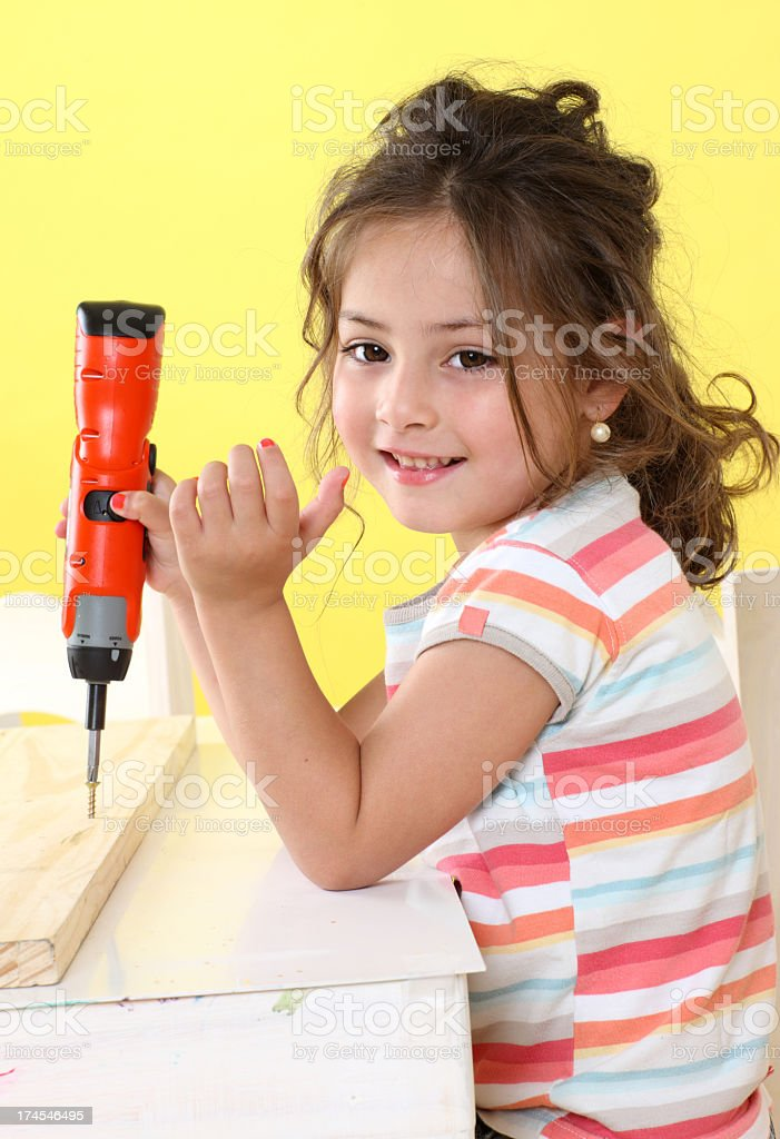 Girl with screwdriver royalty-free stock photo