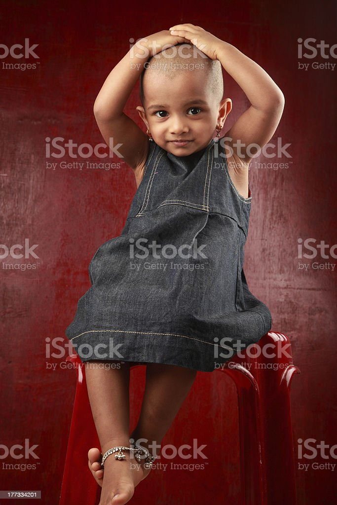 Girl with shaved head stock photo