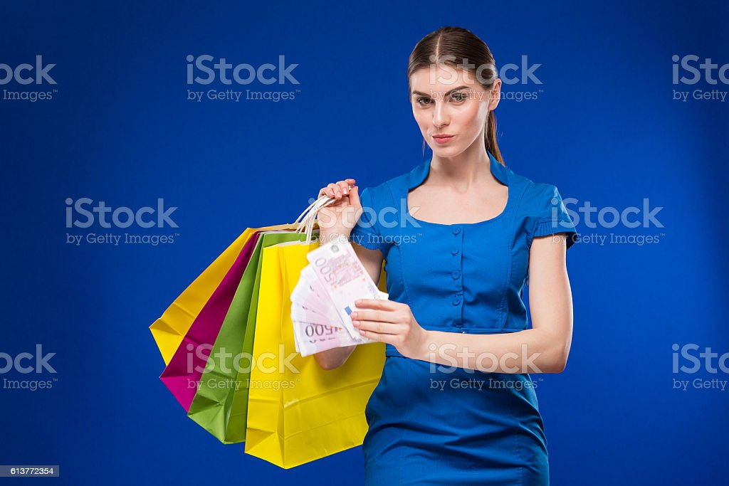 girl with shopping and money stock photo