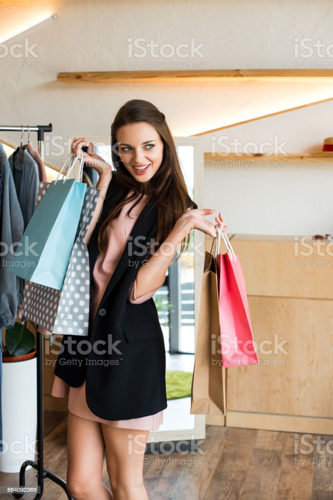 girl with shopping bags in boutique royalty-free stock photo