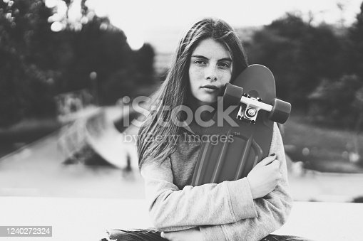 Young woman at the skateboard park
