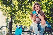 Teenage girl surfing the net on smartphone