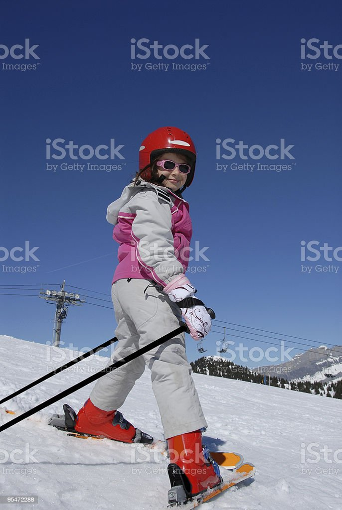 Girl with skis royalty-free stock photo