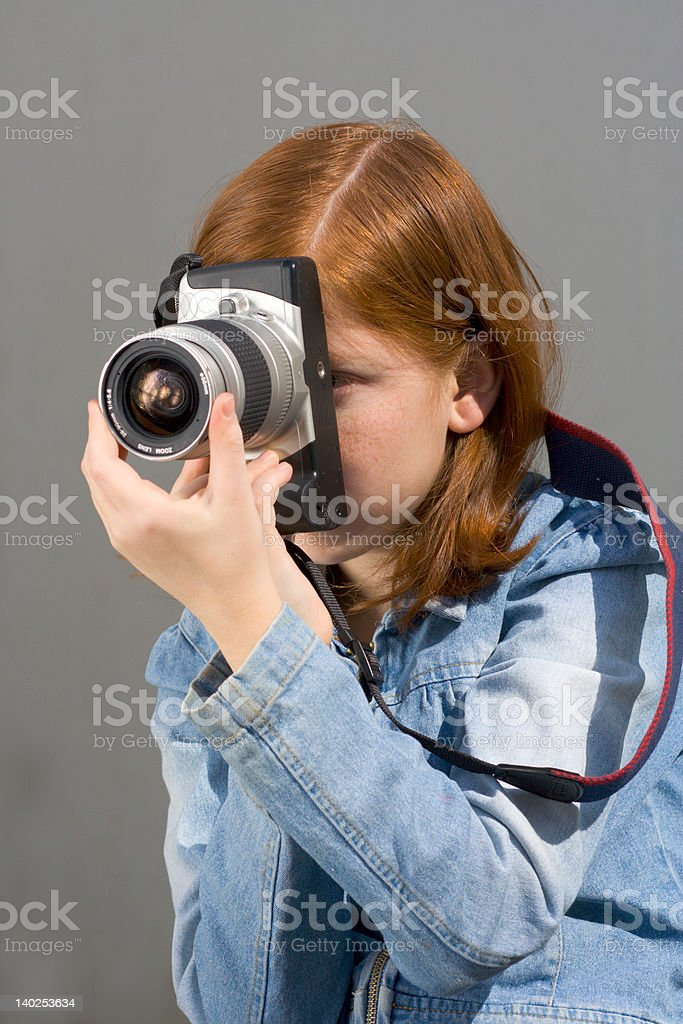 Girl with SLR photo camera royalty-free stock photo