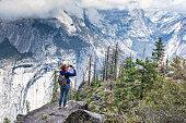 Girl taking photo of Yosemite by phone
