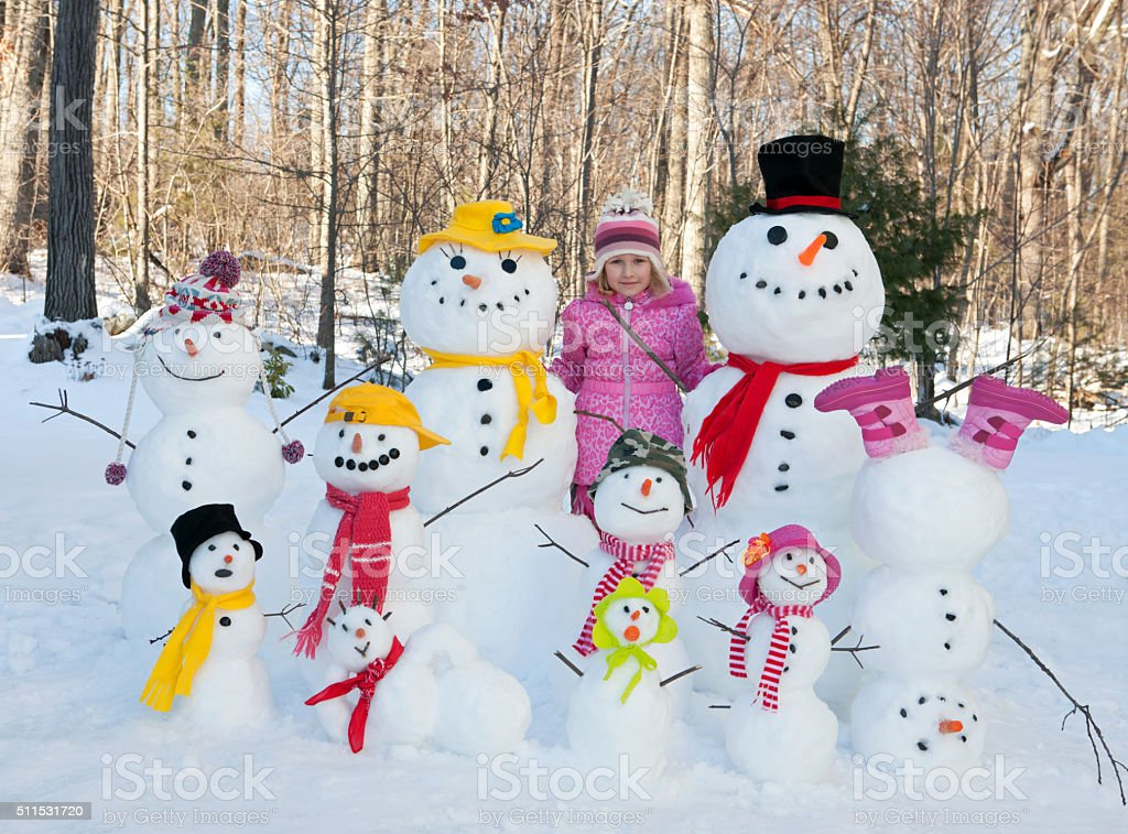 Girl with snowmen stock photo