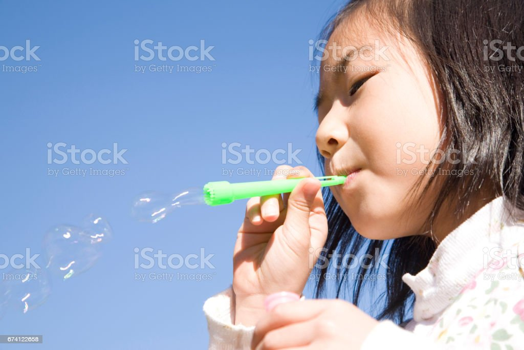 Girl with soap bubbles royalty-free stock photo