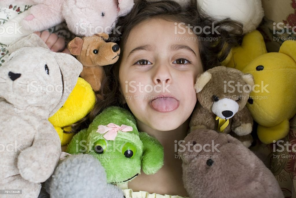 Girl with soft toys 免版稅 stock photo