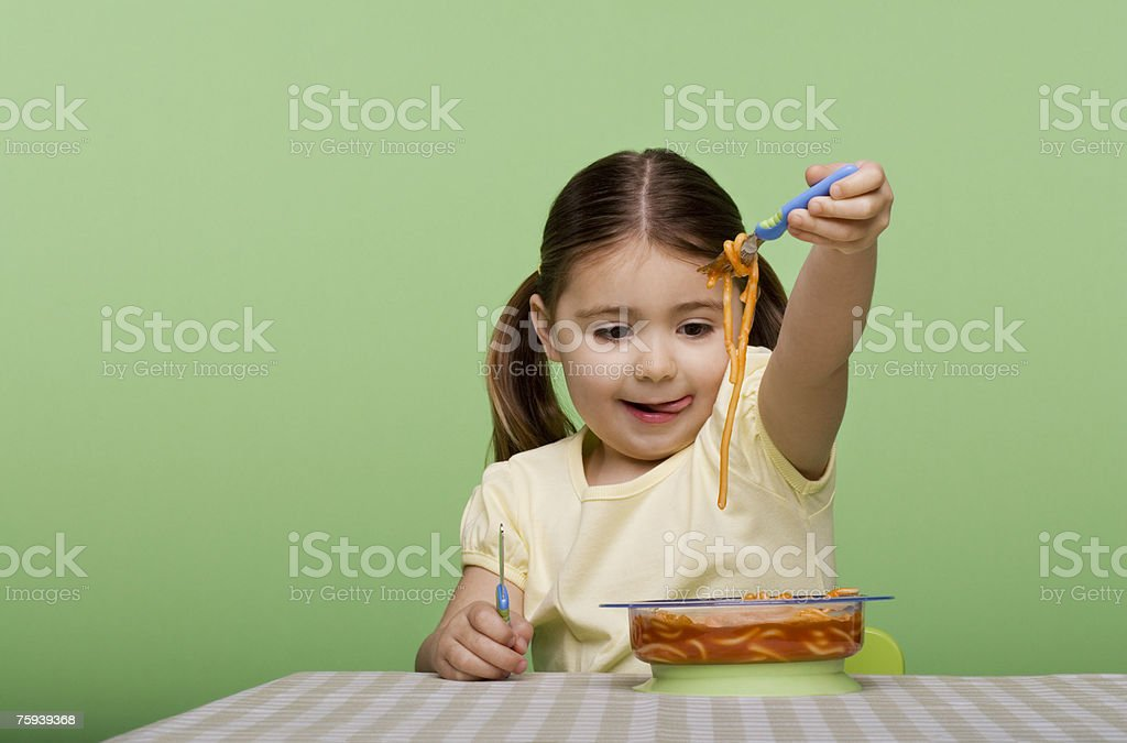 Girl with spaghetti stock photo