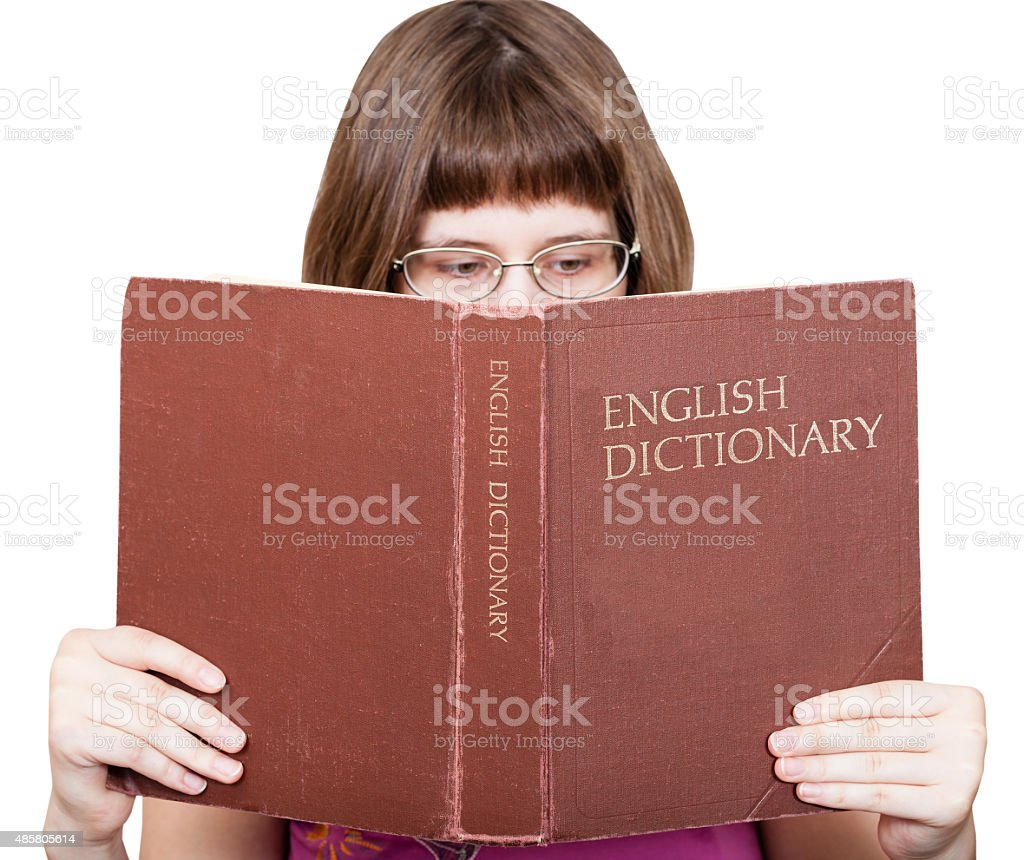 girl with spectacles reads English Dictionary book foto