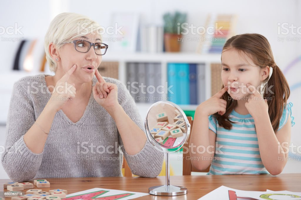 Girl with speech impediment exercising stock photo