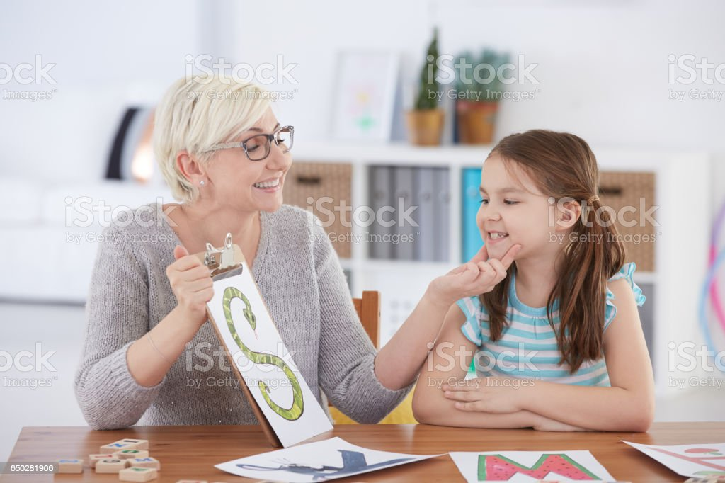Girl with speech impediment stock photo