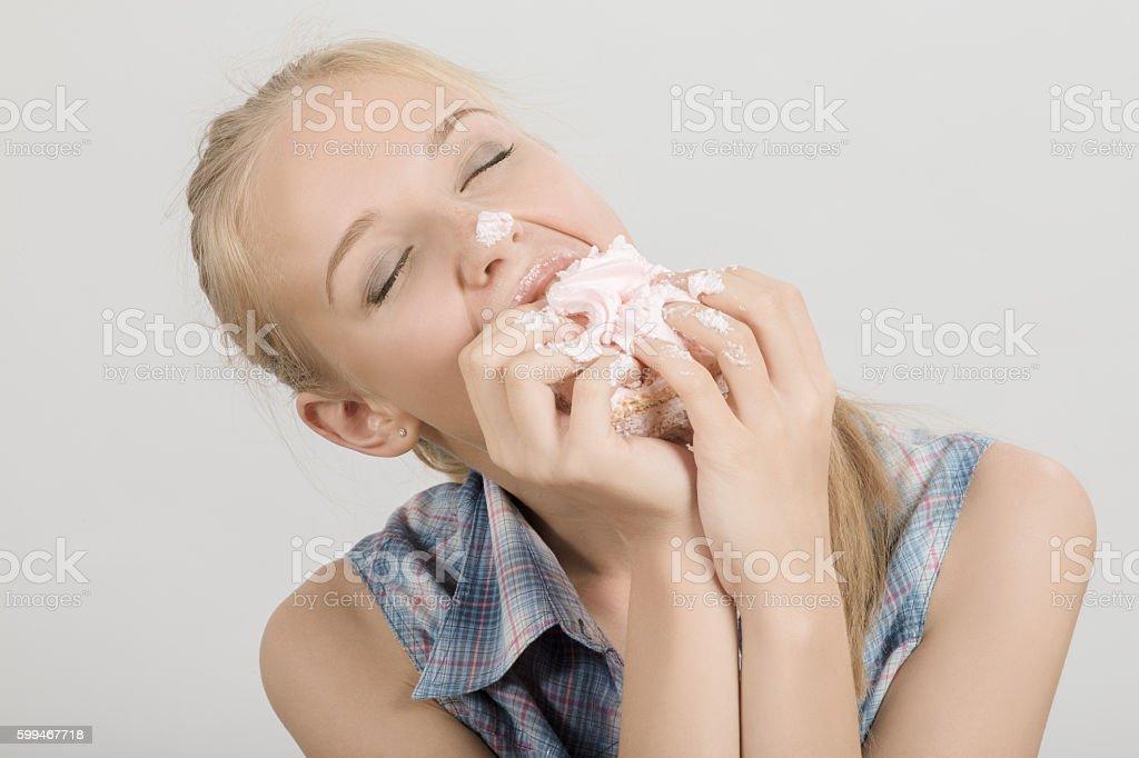 girl with sponge cake stock photo