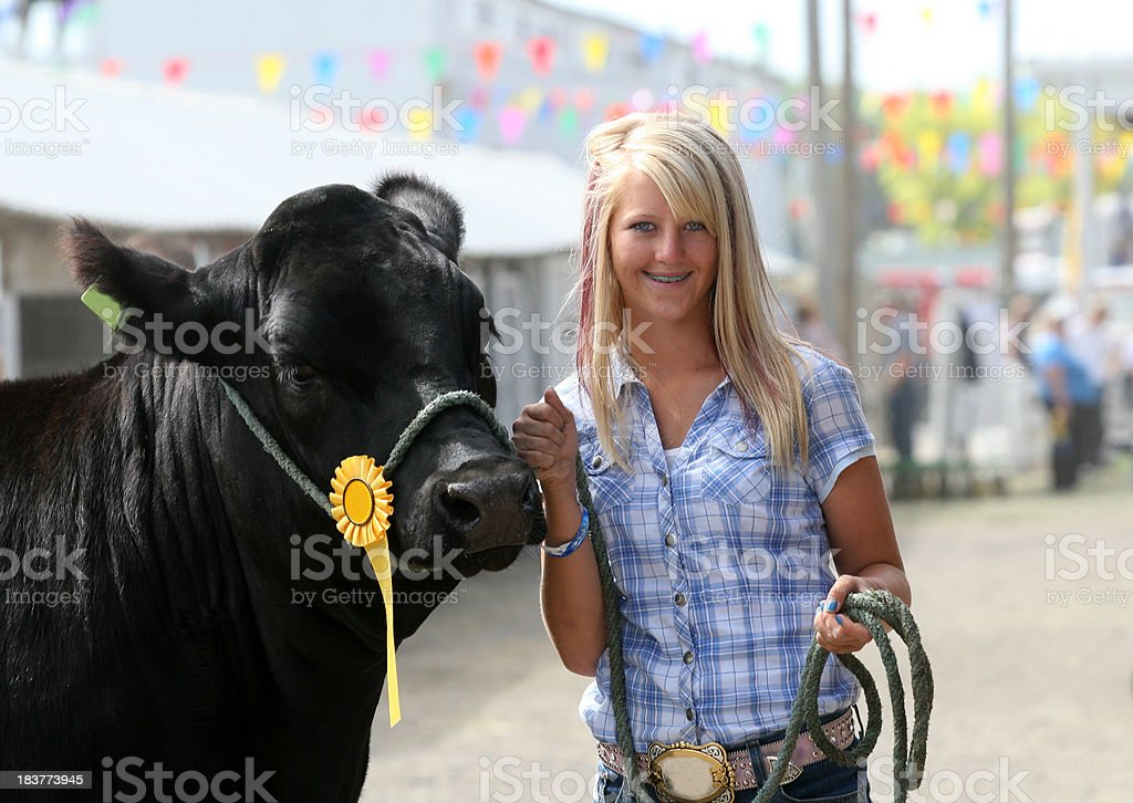 girl with steer stock photo