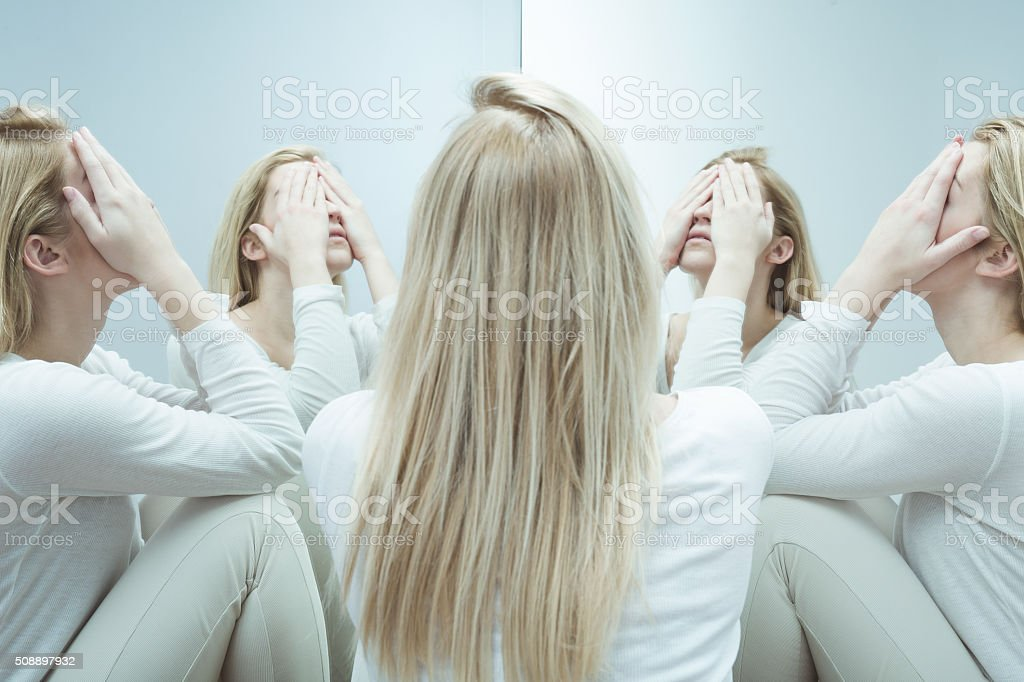 Girl with suicidal thoughts stock photo