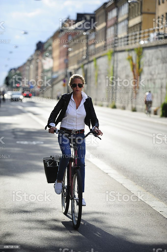 Girl with sunglasses on bicycle royalty-free stock photo